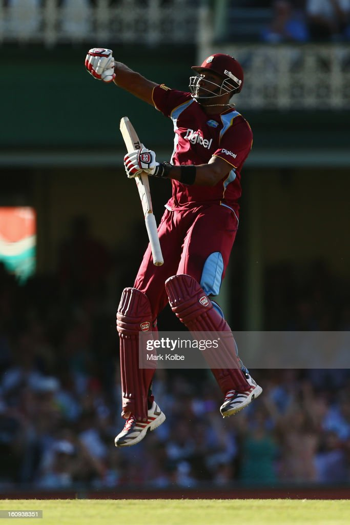 <a gi-track='captionPersonalityLinkClicked' href=/galleries/search?phrase=Kieron+Pollard&family=editorial&specificpeople=4233862 ng-click='$event.stopPropagation()'>Kieron Pollard</a> of West Indies celebrates scoring his century during game four of the Commonwealth Bank One Day International Series between Australia and the West Indies at Sydney Cricket Ground on February 8, 2013 in Sydney, Australia.