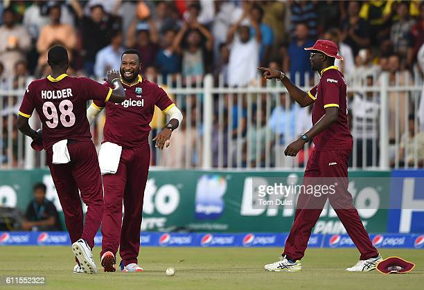 Kieron Pollard of West Indies celebrates taking the wicket of Babar Azam of Pakistan during the first One Day International match between Pakistan...