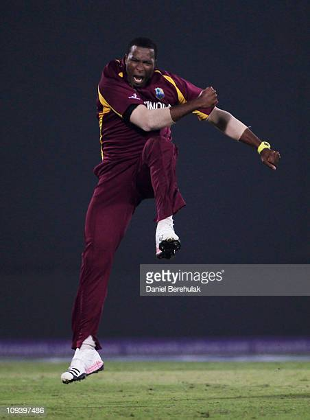 Kieron Pollard of West Indies celebrates the wicket of Graeme Smith of South Africa during the 2011 ICC World Cup Group B match between West Indies...