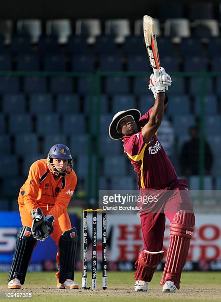 Kieron Pollard of West Indies hits six during the 2011 ICC World Cup group B match between Netherlands and West Indies at Feroz Shah Kotla stadium on...