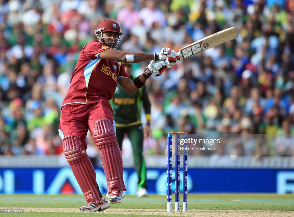 Kieron Pollard of West Indies hits the ball to the boundary during the ICC Champions Trophy group B match between West Indies and Pakistan at The Oval on June 7, 2013 in London, England.