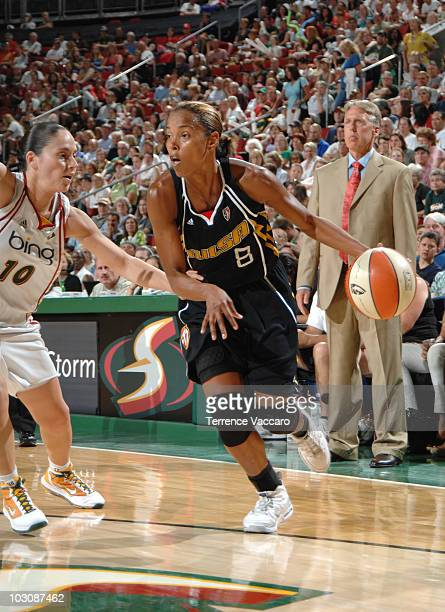 Kiesha Brown of the Tulsa Shock drives against Sue Bird of the Seattle Storm on July 25 2010 at Key Arena in Seattle Washington NOTE TO USER User...