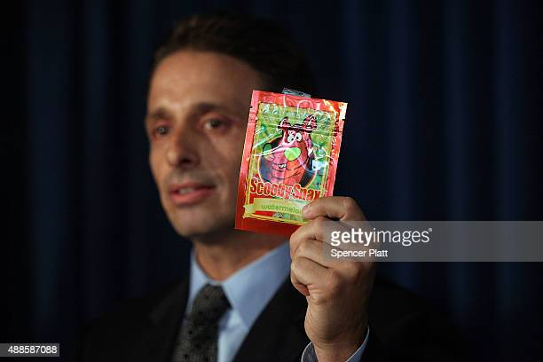 Kieth Kruskall with the Drug Enforcement Administration holds up a package of synthetic marijuana at a news conference with other law enforcement...