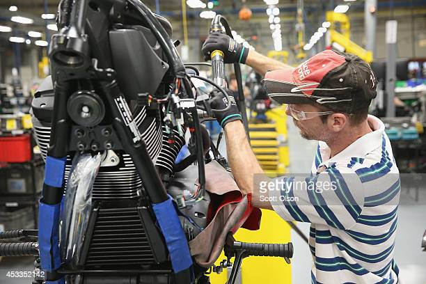 Kieth Miller works on the assembly line building Victory motorcycles at the Polaris Industries factory on August 8 2014 in Spirit Lake Iowa Polaris...