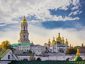 Kiev-Pechersk Lavra against the sky with clouds autumn. Big Bell tower, Refectory Church and Assumption Cathedral. Kiev, Ukraine