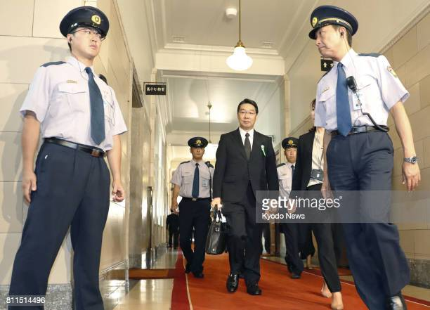 Kihei Maekawa a former top bureaucrat at the education ministry heads to a House of Representatives committee meeting in Tokyo on July 10 to testify...
