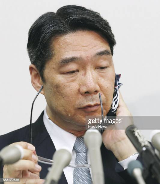 Kihei Maekawa former vice minister of the Ministry of Education Culture Sports Science and Technology wipes his face during a press conference in...
