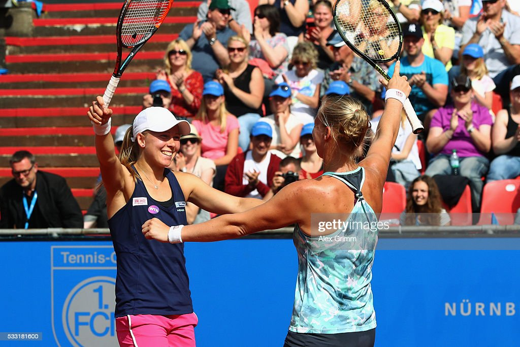 <a gi-track='captionPersonalityLinkClicked' href=/galleries/search?phrase=Kiki+Bertens&family=editorial&specificpeople=7945371 ng-click='$event.stopPropagation()'>Kiki Bertens</a> (front) of Netherlands and <a gi-track='captionPersonalityLinkClicked' href=/galleries/search?phrase=Johanna+Larsson&family=editorial&specificpeople=6727077 ng-click='$event.stopPropagation()'>Johanna Larsson</a> of Sweden celebrate after defeating Shuko Aoyama of Japan and Renata Voracova of Czech Republic in the doubles final match on day eight of the Nuernberger Versicherungscup 2016 on May 21, 2016 in Nuremberg, Germany.