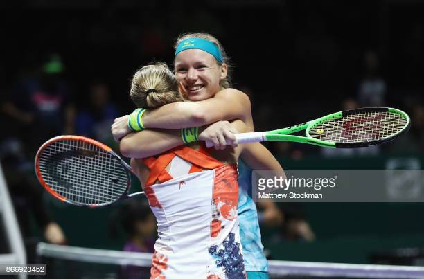 Kiki Bertens of Netherlands and Johanna Larsson of Sweden celebrate victory in their doubles match against Casey Dellacqua and Ashleigh Barty of...