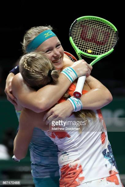 Kiki Bertens of Netherlands and Johanna Larsson of Sweden celebrate victory in the doubles semi final match against Elena Vesnina and Ekaterina...