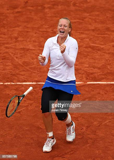 Kiki Bertens of Netherlands celebrates victory during the Ladies Singles quarter final match against Timea Bacsinszky of Switzerland on day twelve of...