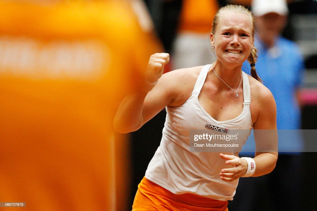 <a gi-track='captionPersonalityLinkClicked' href=/galleries/search?phrase=Kiki+Bertens&family=editorial&specificpeople=7945371 ng-click='$event.stopPropagation()'>Kiki Bertens</a> of Netherlands celebrates winning the match against Kurumi Nara of Japan during the Fed Cup World Group II Play-off between Netherlands and Japan at the Maaspoort Sports end Events on April 20, 2014 in 's-Hertogenbosch, Netherlands.
