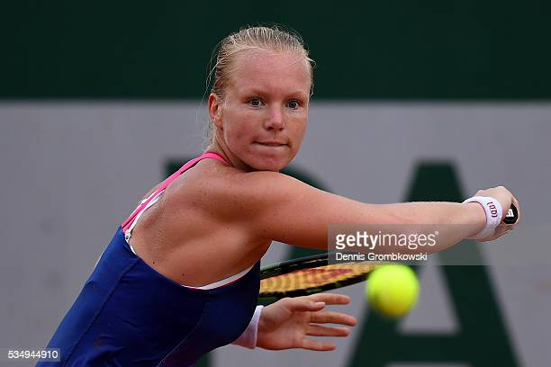 Kiki Bertens of Netherlands hits a backhand during the Ladies Singles third round match against Daria Kasatkina of Russia on day seven of the 2016...