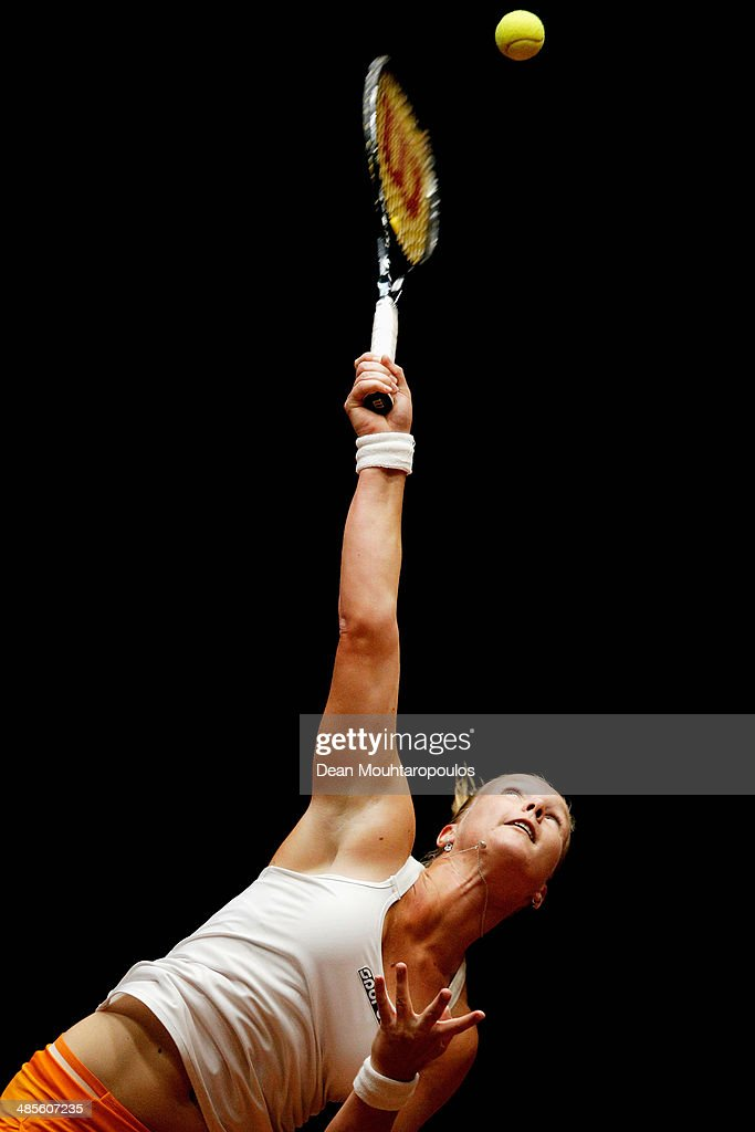 <a gi-track='captionPersonalityLinkClicked' href=/galleries/search?phrase=Kiki+Bertens&family=editorial&specificpeople=7945371 ng-click='$event.stopPropagation()'>Kiki Bertens</a> of Netherlands in action against Misaki Doi of Japan during the Fed Cup World Group II Play-off match between Netherlands and Japan at the Maaspoort Sports end Events on April 19, 2014 in 's-Hertogenbosch, Netherlands.