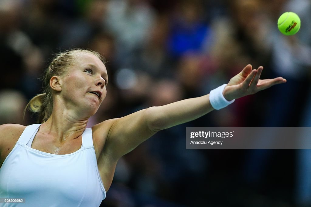 Kiki Bertens (C) of Netherlands in action against Svetlana Kuznetsova of Russia during the Federation Cup World Group First round tennis match in Moscow, Russia on February 7, 2016