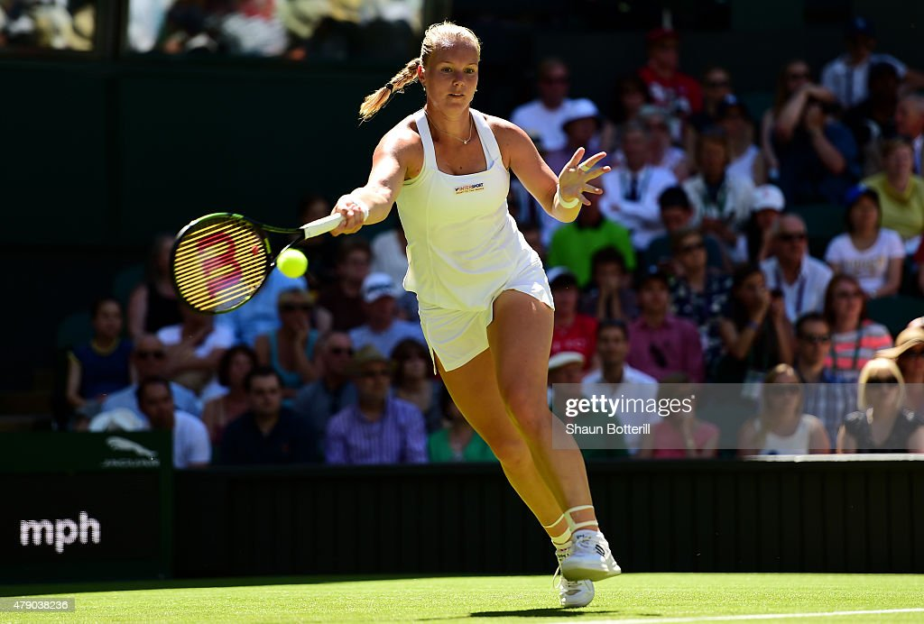 <a gi-track='captionPersonalityLinkClicked' href=/galleries/search?phrase=Kiki+Bertens&family=editorial&specificpeople=7945371 ng-click='$event.stopPropagation()'>Kiki Bertens</a> of Netherlands in action in her Ladies Singles first round match against Petra Kvitova of Czech Republic during day two of the Wimbledon Lawn Tennis Championships at the All England Lawn Tennis and Croquet Club on June 30, 2015 in London, England.