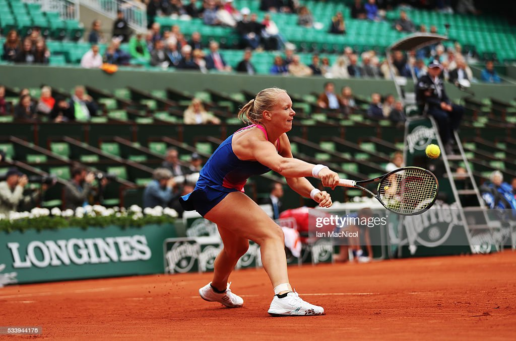 <a gi-track='captionPersonalityLinkClicked' href=/galleries/search?phrase=Kiki+Bertens&family=editorial&specificpeople=7945371 ng-click='$event.stopPropagation()'>Kiki Bertens</a> of Netherlands plays a shot during the Women's Singles first round match against Angelique Kerber of Germany on day three of the 2016 French Open at Roland Garros on May 24, 2016 in Paris, France .