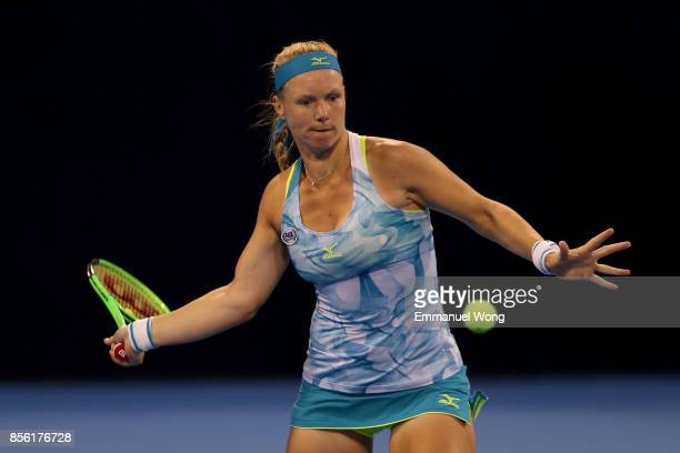 Kiki Bertens of Netherlands returns a shot against Andrea Petkovic of Germany on day two of the 2017 China Open at the China National Tennis Centre...