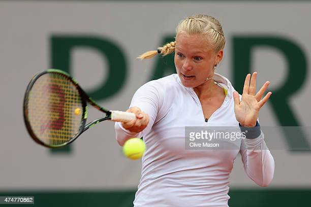 Kiki Bertens of Netherlands returns a shot during her Women's Singles match against Svetlana Kuznetsova of Russia on day three of the 2015 French...