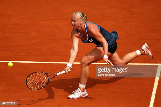 Kiki Bertens of Netherlands returns a shot during her women's singles match against Andrea Petkovic of Germany on day nine of the French Open at...