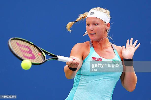 Kiki Bertens of Netherlands returns a shot to Serena Williams of the United States during their Women's Singles Second Round match on Day Three of...