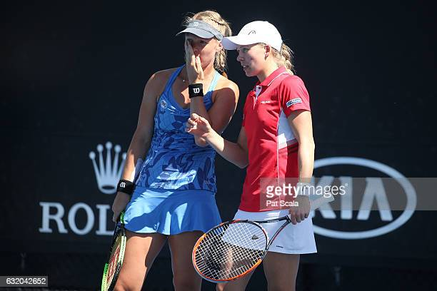 Kiki Bertens of the Netherlands and Johanna Larsson of Sweden talk tactics in their first round doubles match against Shelby Rogers and Taylor...
