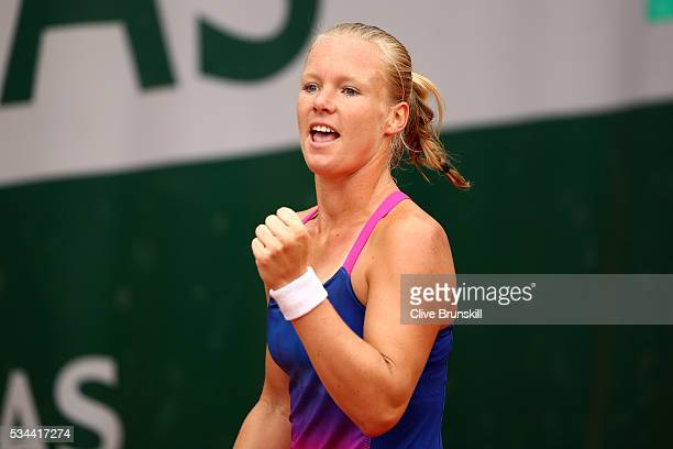 Kiki Bertens of the Netherlands celebrates at match point during the Women's Singles second round match against Camila Giorgi of Italy on day five of...