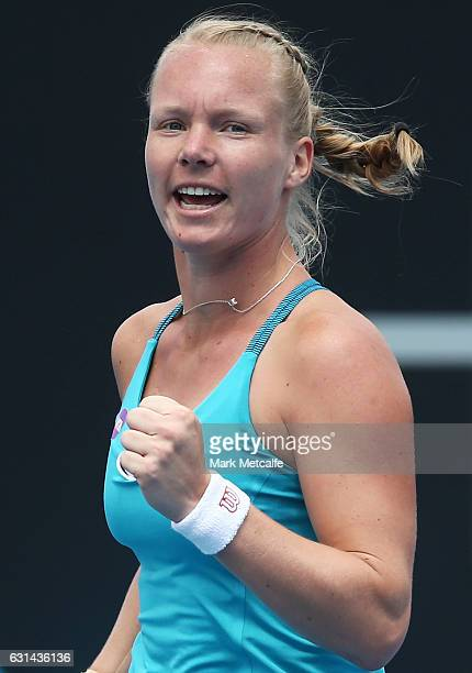 Kiki Bertens of the Netherlands celebrates winning match point in her second round match against Galina Voskoboeva of Kazakhstan during day two of...
