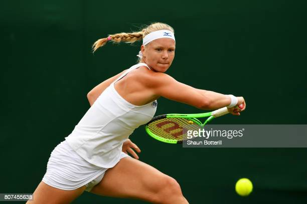 Kiki Bertens of The Netherlands plays a backhand during the Ladies Singles first round match against Sorana Cirstea of Romania on day two of the...