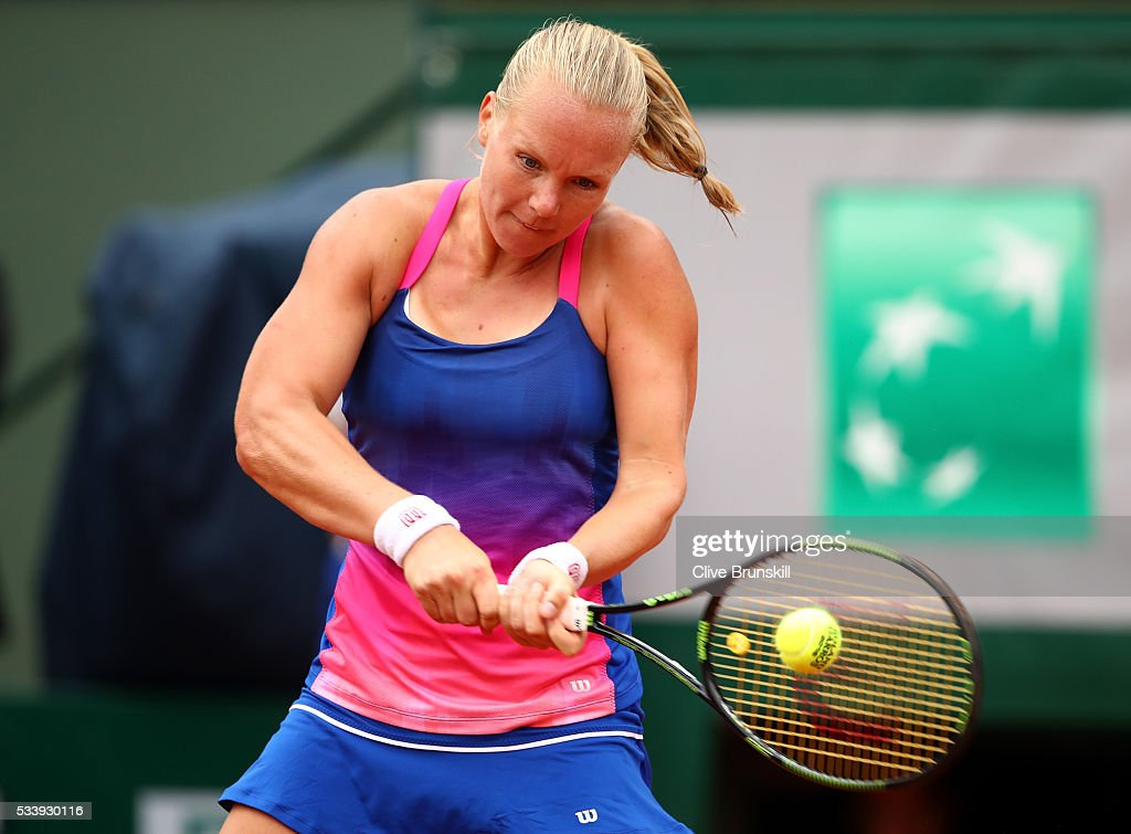 <a gi-track='captionPersonalityLinkClicked' href=/galleries/search?phrase=Kiki+Bertens&family=editorial&specificpeople=7945371 ng-click='$event.stopPropagation()'>Kiki Bertens</a> of the Netherlands plays a backhand during the Women's Singles first round match against Angelique Kerber of Germany on day three of the 2016 French Open at Roland Garros on May 24, 2016 in Paris, France.