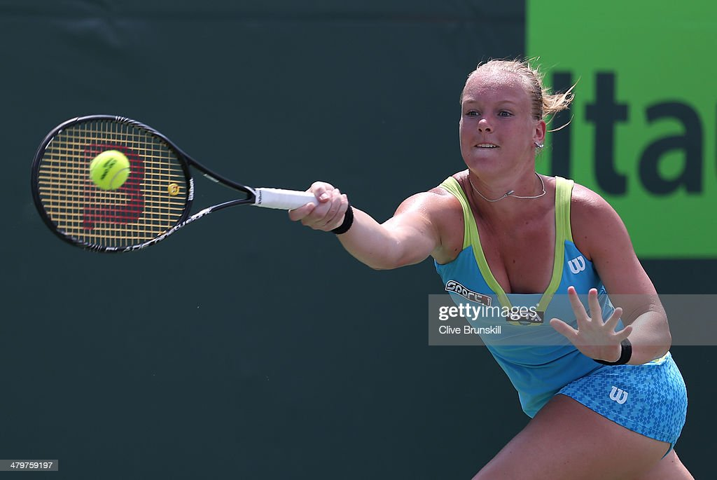 <a gi-track='captionPersonalityLinkClicked' href=/galleries/search?phrase=Kiki+Bertens&family=editorial&specificpeople=7945371 ng-click='$event.stopPropagation()'>Kiki Bertens</a> of the Netherlands plays a forehand against Sam Stosur of Australia during their second round match during day 4 at the Sony Open at Crandon Park Tennis Center on March 20, 2014 in Key Biscayne, Florida.