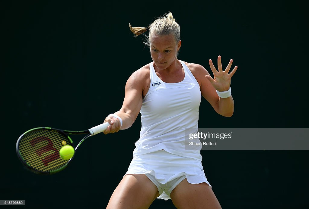 <a gi-track='captionPersonalityLinkClicked' href=/galleries/search?phrase=Kiki+Bertens&family=editorial&specificpeople=7945371 ng-click='$event.stopPropagation()'>Kiki Bertens</a> of The Netherlands plays a forehand during the Ladies Singles second round match against Mona Barthel of Germany on day four of the Wimbledon Lawn Tennis Championships at the All England Lawn Tennis and Croquet Club on June 30, 2016 in London, England.