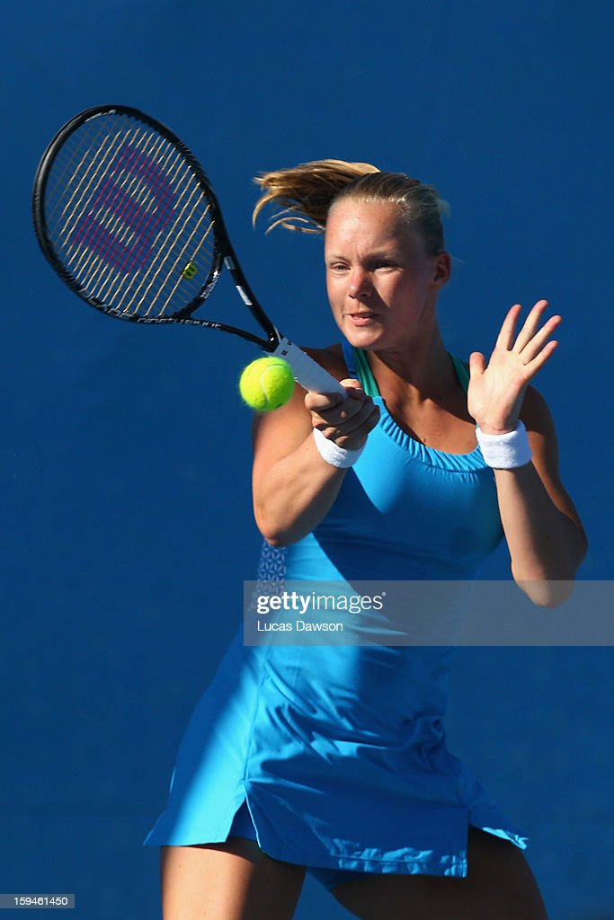 Kiki Bertens of the Netherlands plays a forehand in her first round match against Lucie Hradecka of the Czech Republic during day one of the 2013 Australian Open at Melbourne Park on January 14, 2013 in Melbourne, Australia.