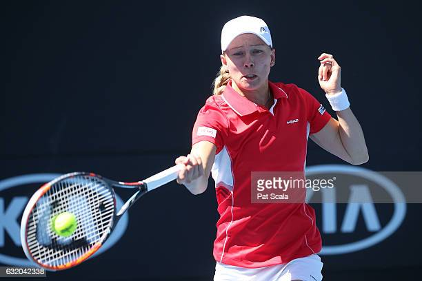 Kiki Bertens of the Netherlands plays a shot in her first round doubles match against Shelby Rogers and Taylor Townsend of the United Stateson day...