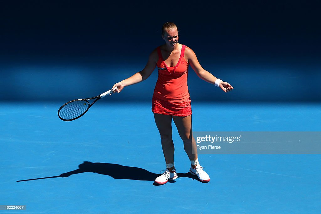 <a gi-track='captionPersonalityLinkClicked' href=/galleries/search?phrase=Kiki+Bertens&family=editorial&specificpeople=7945371 ng-click='$event.stopPropagation()'>Kiki Bertens</a> of the Netherlands reacts in her first round match against Ana Ivanovic of Serbia during day one of the 2014 Australian Open at Melbourne Park on January 13, 2014 in Melbourne, Australia.