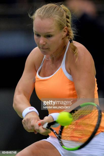 Kiki Bertens of The Netherlands returns the ball to Aliaksandra Sasnovich of Belarus during the Fed Cup World Group first round tennis match between...