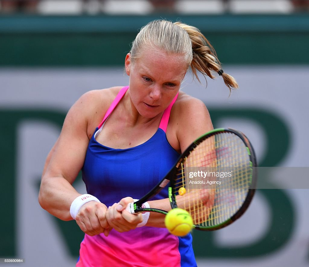 Kiki Bertens of the Netherlands returns the ball to Angelique Kerber of Germany during their women's single first round match at the French Open tennis tournament at Roland Garros in Paris on May 24, 2016.