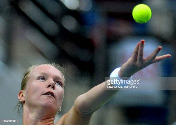 Kiki Bertens of The Netherlands serves the ball to Aliaksandra Sasnovich of Belarus during the Fed Cup World Group first round tennis match between...