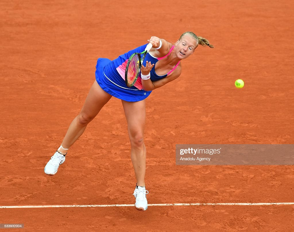Kiki Bertens of the Netherlands serves to Angelique Kerber of Germany during their women's single first round match at the French Open tennis tournament at Roland Garros in Paris on May 24, 2016.