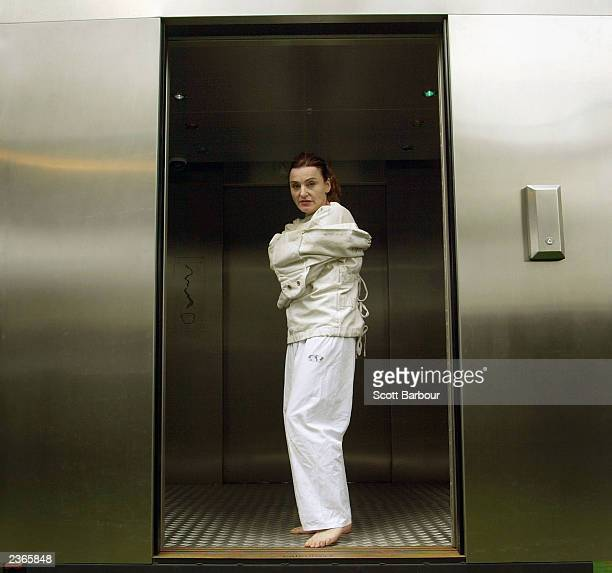 Kiki Kendrick acts in a straitjacket during her solo performance 'Insane Jane' performed inside a lift at the 57th Edinburgh Fringe Festival 2003...