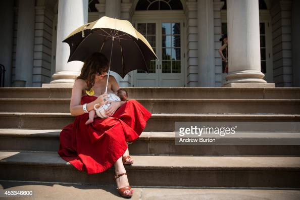 Kiki Valentine breastfeeds her 9weekold son Hart Valentine on the steps of City Hall during a ralley to support breastfeeding in public on August 8...