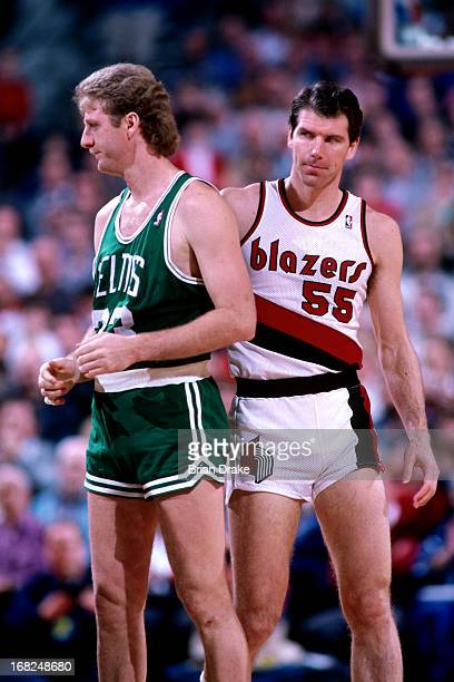 Kiki Vandeweghe of the Portland Trail Blazers stands next to Larry Bird of the Boston Celtics during a game played circa 1987 at the Veterans...