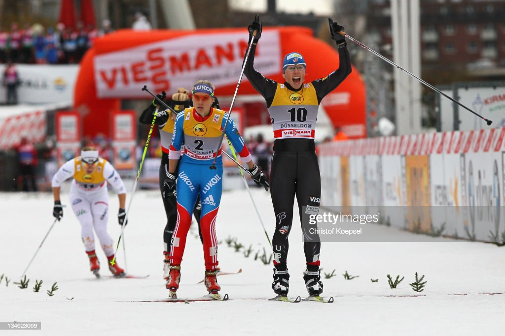 Kikkan Randall of the United States (R) celebrates winning the women's 0.9 km sprint of the FIS Cross Country World Cup at the Dusseldorf city circuit on December 3, 2011 in Duesseldorf, Germany.