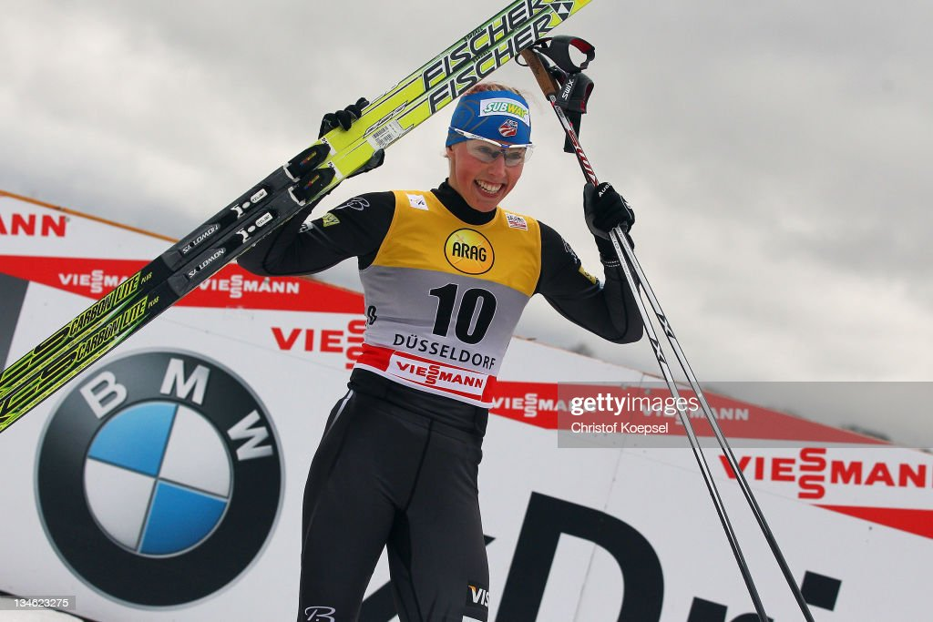 Kikkan Randall of the United States celebrates winning the women's 0.9 km sprint of the FIS Cross Country World Cup at the Dusseldorf city circuit on December 3, 2011 in Duesseldorf, Germany.