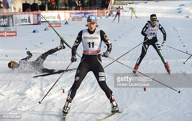 US Kikkan Randall wins the Women's CrossCountry sprint in the FIS World Cup Ski Games in Lahti Finland on March 1 2014 At left Third placed US Sophie...