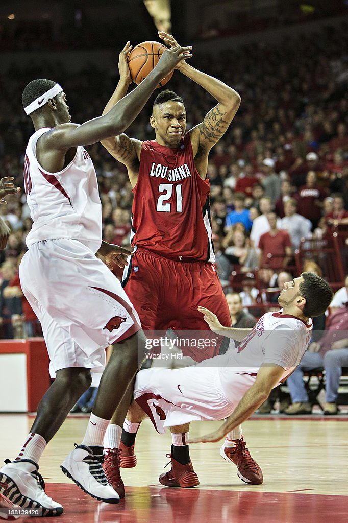 Kikko Haydar #20 of the Arkansas Razorbacks falls back on a called charge by Shawn Long #21 of the Louisiana Ragin' Cajuns at Bud Walton Arena on November 15, 2013 in Fayetteville, Arkansas. The Razorbacks defeated the Ragin' Cajuns 76-63.