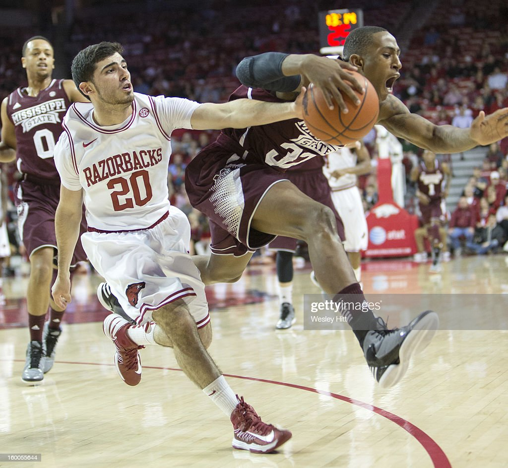 Kikko Haydar #20 of the Arkansas Razorbacks goes for a loose ball and fouls Craig Sword #32 of the Mississippi State Bulldogs at Bud Walton Arena on January 23, 2013 in Fayetteville, Arkansas. The Razorbacks defeated the Bulldogs 96-70.