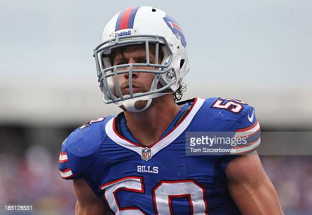 Kiko Alonso of the Buffalo Bills reacts after stopping the Cincinnati Bengals during NFL game action at Ralph Wilson Stadium on October 13 2013 in...