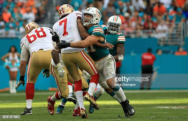 Kiko Alonso of the Miami Dolphins hits Colin Kaepernick of the San Francisco 49ers after a pass during a game on November 27 2016 in Miami Gardens...