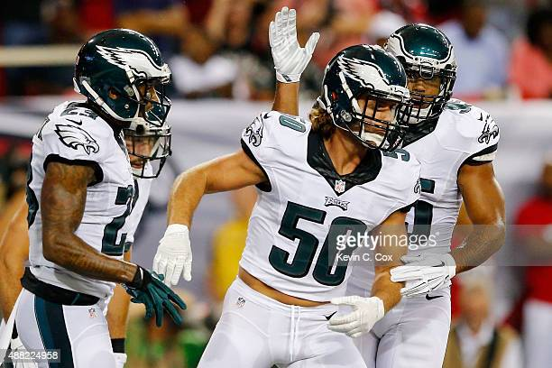 Kiko Alonso of the Philadelphia Eagles celebrates with teammates after an interception during the first half against the Atlanta Falcons at the...
